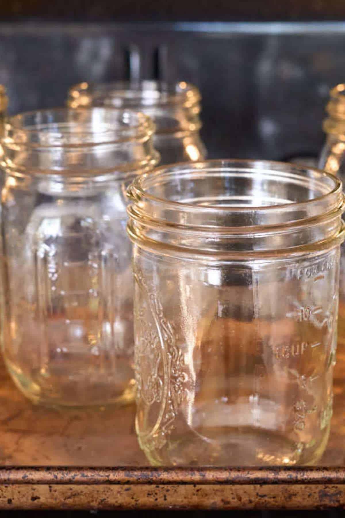 empty mason jars heating in oven