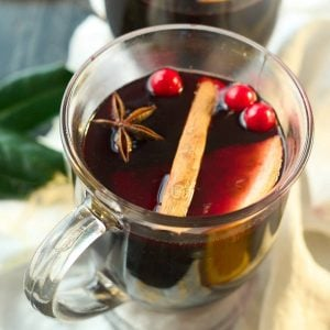 2 clear mugs with mulled wine