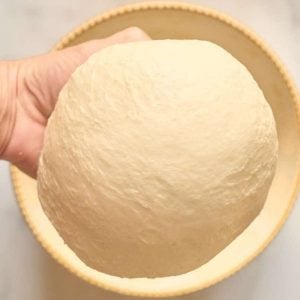 ball of dough in hand