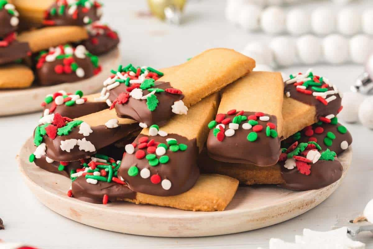 white plate with chocolate-covered shortbread cookies
