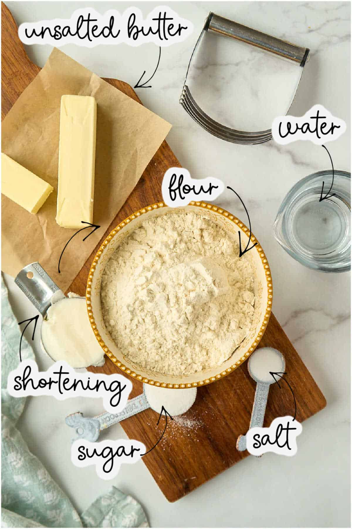 flour, water, butter, salt, sugar, and Crisco on marble counter